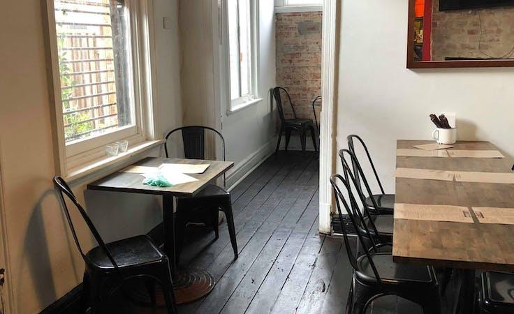 Rustic back room of independent restaurant, image 1