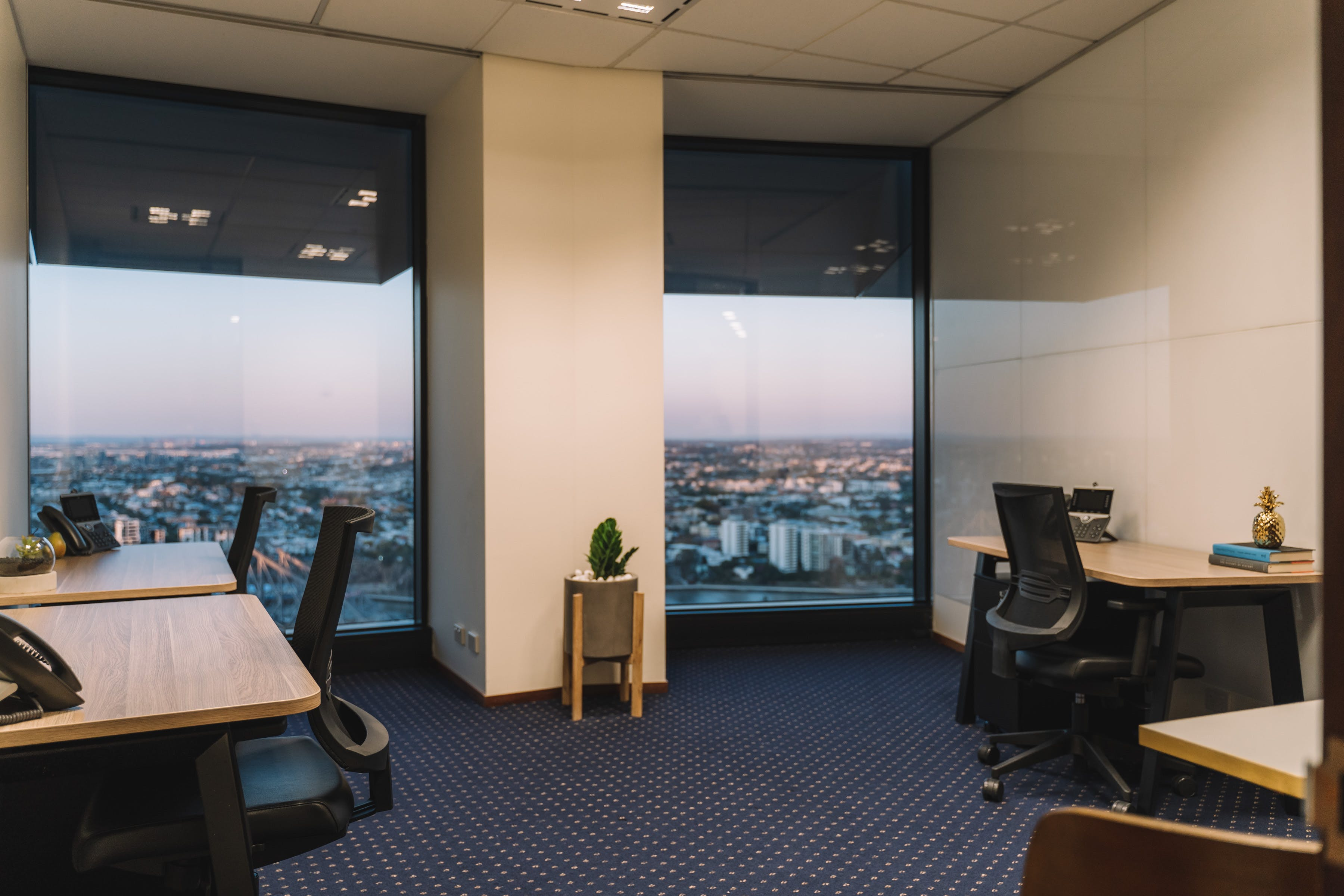 Collaborative 8-person workspace with amazing views of Brisbane CBD, serviced office at Riparian Plaza, image 11