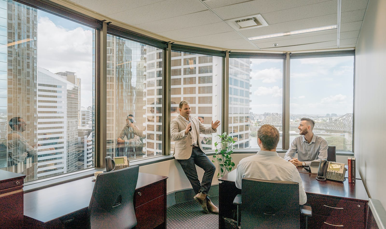 4-person collaborative workspace with views of Brisbane, serviced office at Santos Place, image 1