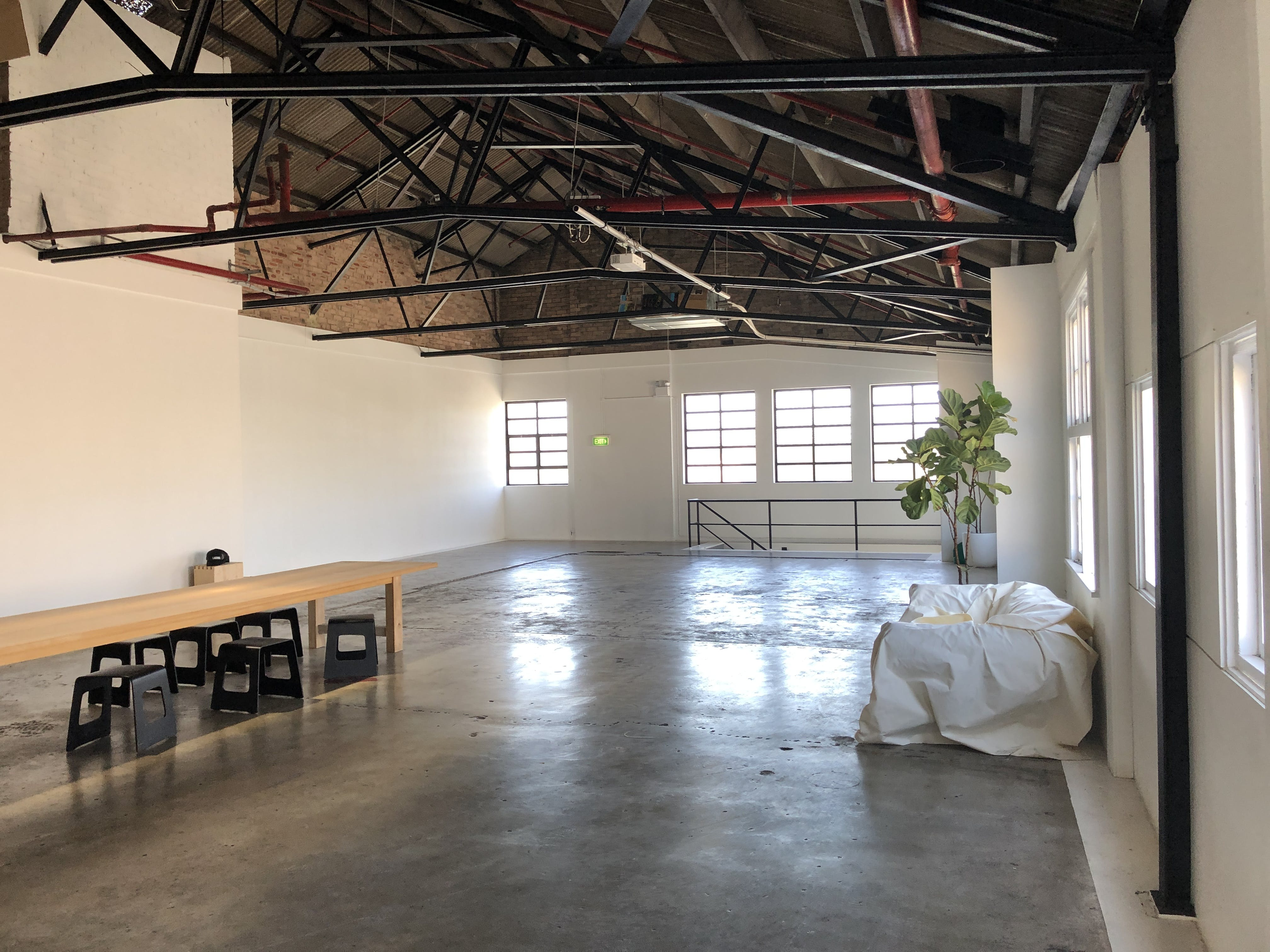 A beautifully lit and spacious warehouse, image 1