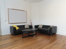 A warm, spacious lounge room in the centre of Fitzroy North, image 1