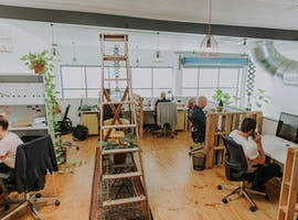 Hot desk in a converted warehouse located in Fortitude Valley, image 1