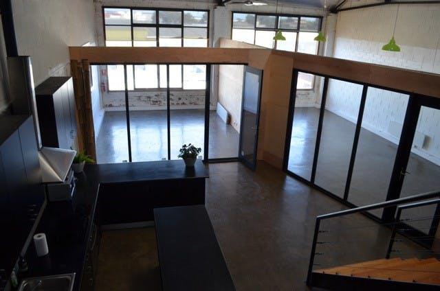 Sleek studio space within converted warehouse, image 1